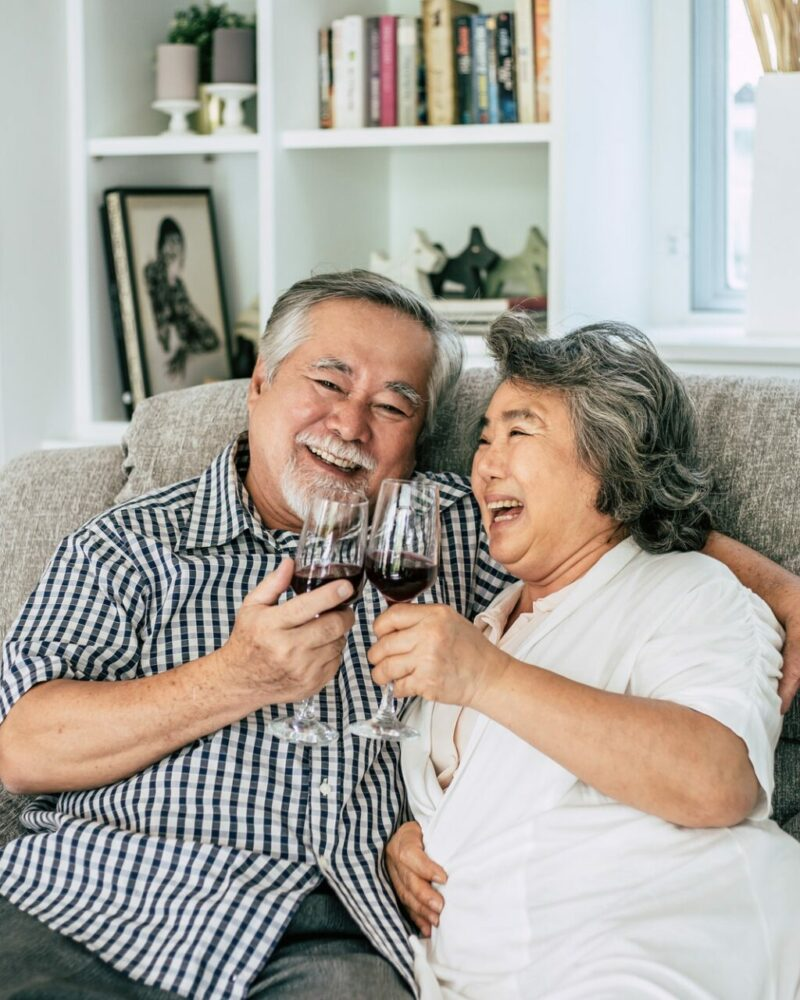 happy-elderly-woman-and-her-husband-drinking-wine-and-happiness.jpg